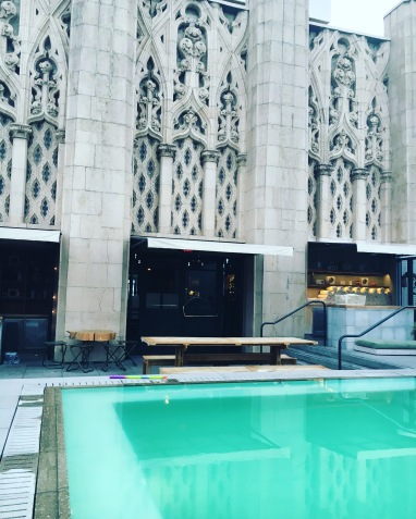 Rooftop pool set amongst the beautiful architecture of the Ace Hotel